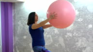 Woman exercises with fitness ball video