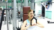 Woman exercising in a fitness center. video