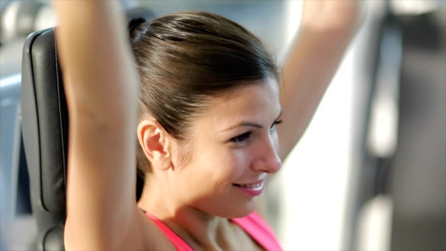 Woman exercising in a gym video