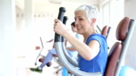 Woman exercising in gym video
