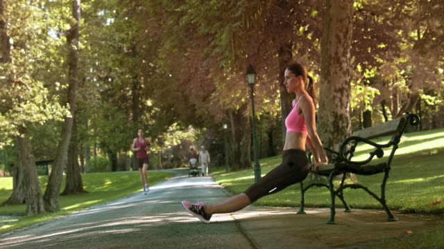 DS Woman exercising on a park bench video