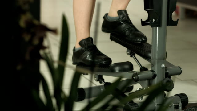 HD DOLLY: Woman Exercising On The Stair Climbing Machine video