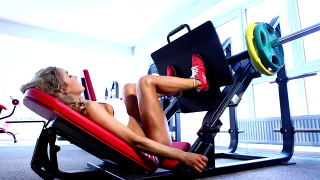 Woman exercising on weightlifting machine video