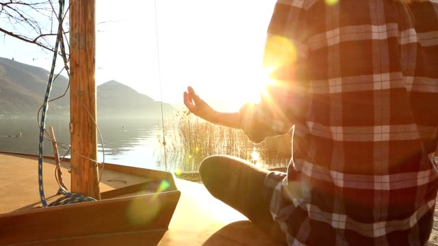 Woman exercising yoga in nature, lake mountain landscape video