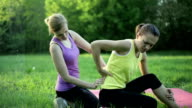 Woman experiencing backache after exercise video