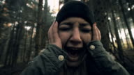 Woman experiencing panic attack in the forest video