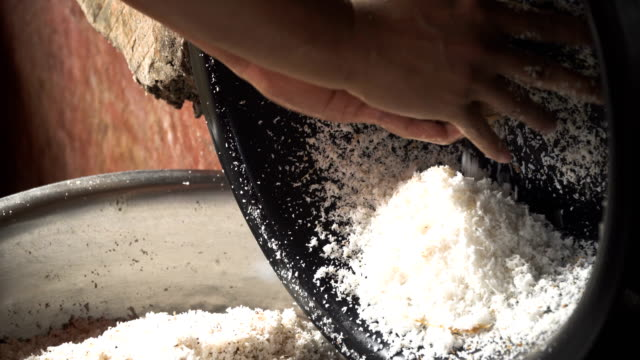 Woman extraction of coconut pulp video