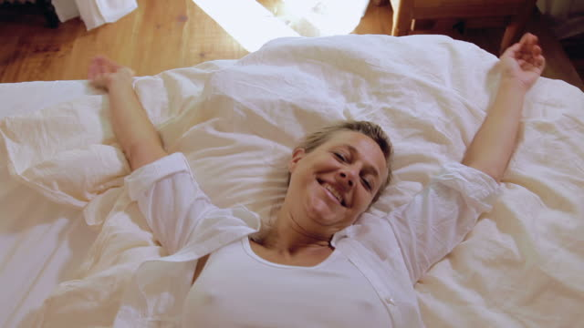 Woman falling in bed video