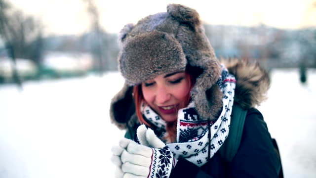 Woman Feeling Cold Warming Hands By Blowing On Them video