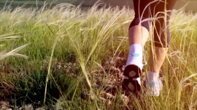 Woman Feet Running Through Grass Sunset Exercise Concept video