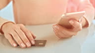SLO MO woman finalizing credit card purchase over the phone video