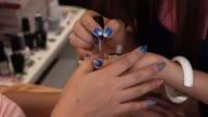 woman fingernail manicure in beauty salon video