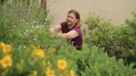 Woman gardening in front yard video