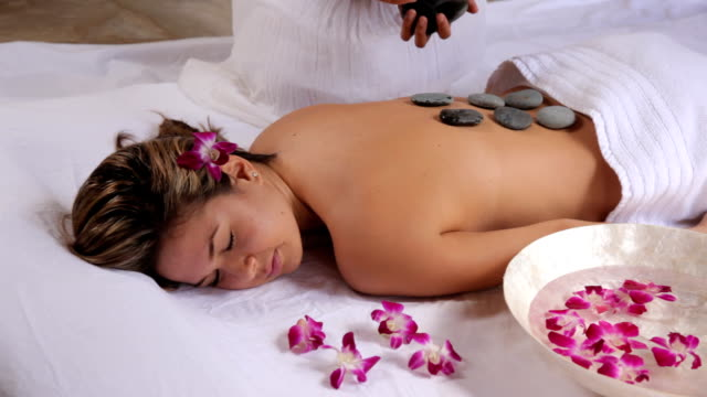 Woman gets hot stone spa treatment video