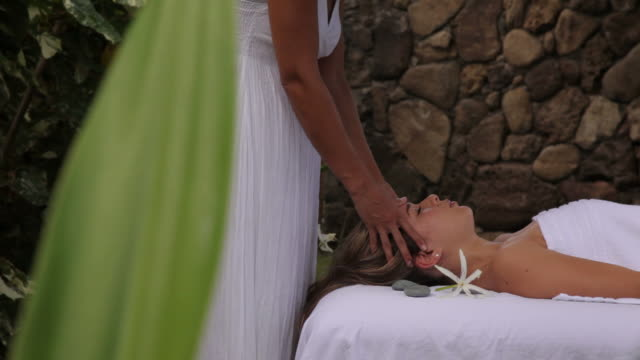 Woman gets massage at tropical resort spa video
