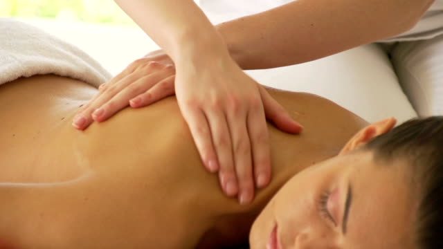 Woman getting a back massage video