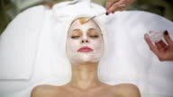 Woman getting a facial treatment at the health spa salon video