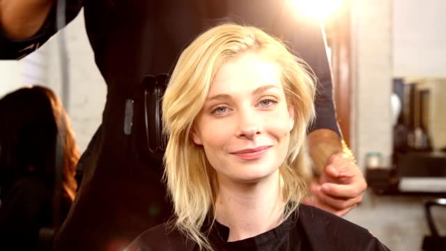 Woman getting her hair dried with hair dryer video