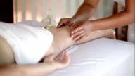 Woman getting massage treatment in beautiful spa video