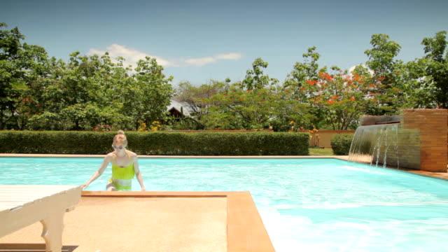 Woman Getting out of a Swimming Pool in Bikini video