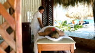 Woman getting professional massage on tropical resort video