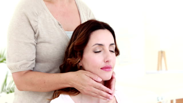 Woman getting reiki therapy video