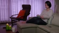 Woman Girl Relaxing On Sofa At Home With Ipad Tablet video