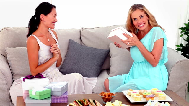 Woman giving her friend a present video
