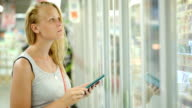 Woman going shopping with check list on pad video