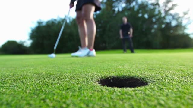 Woman golfs video