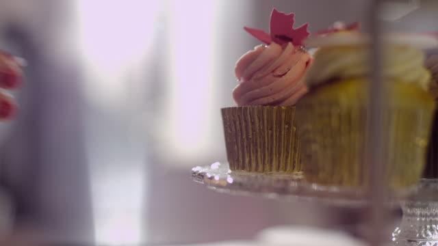 Woman grabbing cupcake video