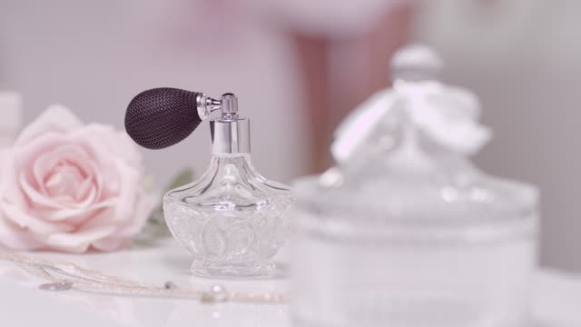 Woman grabbing perfume video
