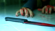 Woman hand holding knife with blood video