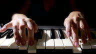 Woman hand playing a MIDI controller keyboard synthesizer close up. video