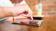 Woman hand using digital tablet at coffee cafe video