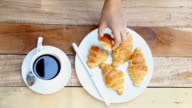 woman hand with black coffee and croissant video