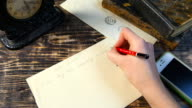 Woman hand write letter on vintage background video