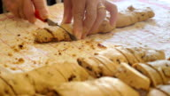 woman hands carefully cut the 'tozzetti', typical Italian biscuits video