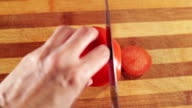 Woman hands cutting a tomato video