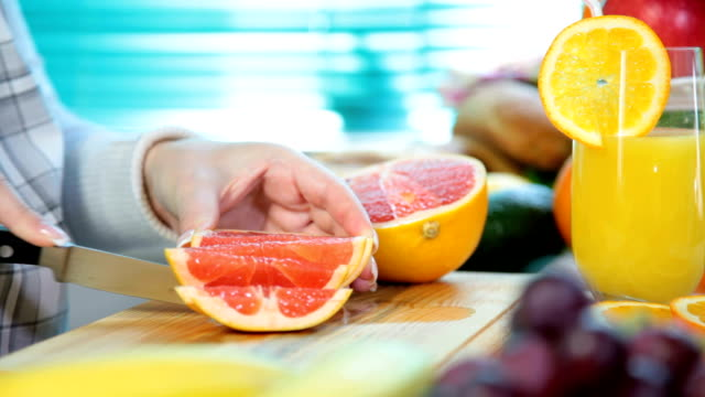 Woman hands cutting grapefruit video
