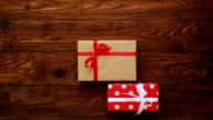 Woman hands folding presents over wooden flat lay video