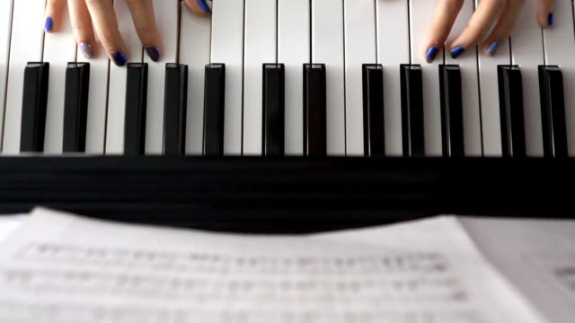 Woman Hands on Piano - Top view video