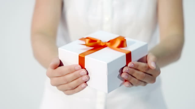 Woman hands over a gift video