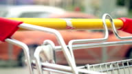 Woman  hands takeing shopping cart at street video