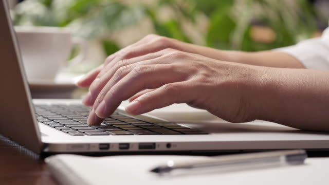 Woman hands typing on the keyboard of laptop computer. Hight quality shot, UHD, 4K video