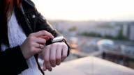 Woman hands using her smartwatch touchscreen video