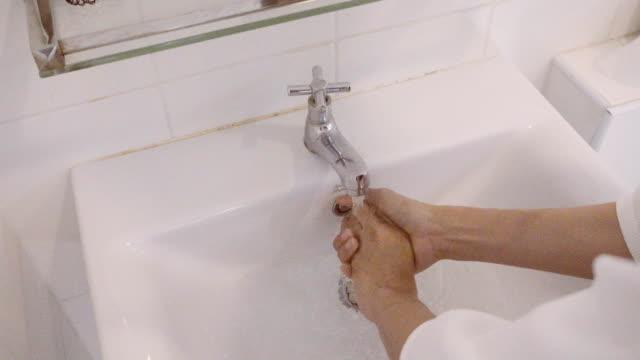 4K CU : Woman Hands washing hands in bathroom, close-up of hands video