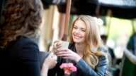 Woman have coffee at outdoor Cafe. video