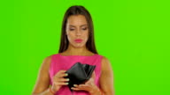 Woman have no money in the wallet. Green screen. Close up video