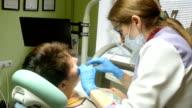 Woman Having A Check Up At Dentist Surgery video